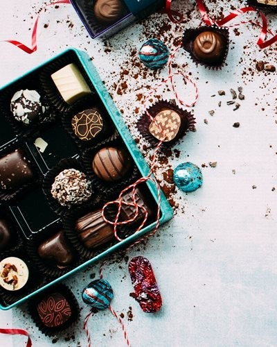 Scented candles, snacks and luxury chocolates
